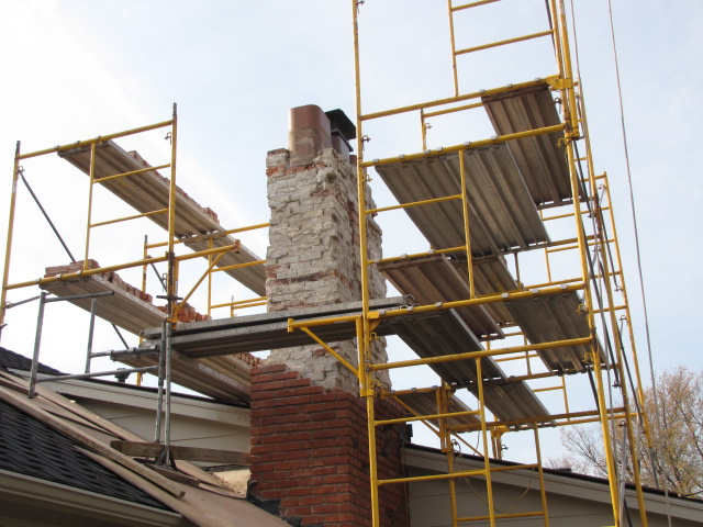 Chimney being repaired to replace bad masonry