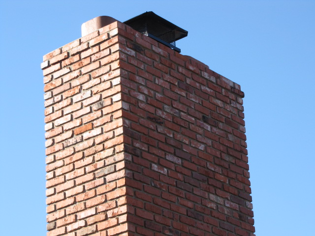 Repaired chimney with damaged brick replaced